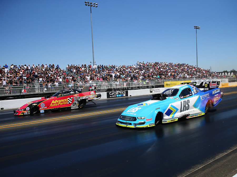 Jul 30, 2017; Sonoma, CA, USA; NHRA funny car driver Tim Wilkerson (right) alongside Courtney Force during the Sonoma Nationals at Sonoma Raceway. Mandatory Credit: Mark J. Rebilas-USA TODAY Sports