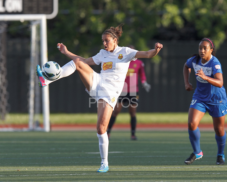 Western New York Flash midfielder Carli Lloyd (10) attempts to control the ball. In a National Women's Soccer League Elite (NWSL) match, the Boston Breakers (blue) tied Western New York Flash (white), 2-2, at Dilboy Stadium on June 5, 2013.