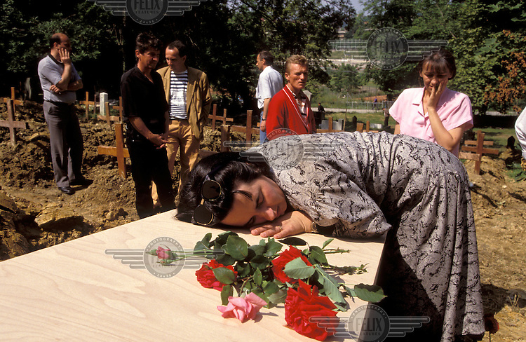 The siege of Sarajevo. Woman grieving on the coffin of a victim of the fighting. .Around 250,000 people died in the civil war between Bosnian Muslims, Croats and Serbs in the years 1992-1995, part of the break-up of the former Yugoslavia.