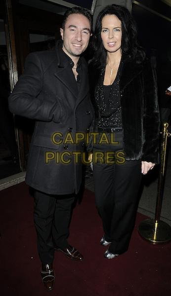 "VINCENT SIMONE & GUEST .At the ""Love Story"" Press Night, Duchess Theatre, Catherine Street, London, England, UK, 6th December 2010..full length black coat trousers fur  jacket .CAP/CAN.©Can Nguyen/Capital Pictures."