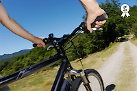 Man speeding on mountain bike (blurred motion) (Licence this image exclusively with Getty: http://www.gettyimages.com/detail/sb10065474ar-001 )