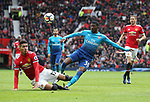 Ainsley Maitland-Niles of Arsenal sees his shot blocked by Chris Smalling of Manchester United during the premier league match at the Old Trafford Stadium, Manchester. Picture date 29th April 2018. Picture credit should read: Simon Bellis/Sportimage