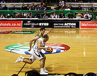Tall Blacks guard Mike Fitchett drives down the court with Brad Newley in pursuit during the International basketball match between the NZ Tall Blacks and Australian Boomers at TSB Bank Arena, Wellington, New Zealand on 25 August 2009. Photo: Dave Lintott / lintottphoto.co.nz