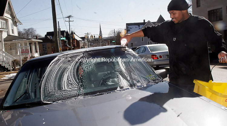 WATERBURY, CT07 March 2006-030706TK13 Moderating temperature throughout the Waterbury area,  Rafael Martinez took advantage of the warming sun give his car a quick was on Central Avenue in Waterbury Tuesday afternoon.     Tom Kabelka / Republican-American (Rafael Martinez)CQ