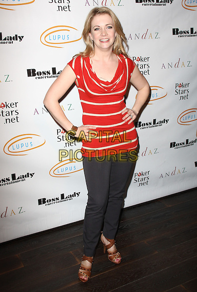 "MELISSA JOAN HART. Lupus LA Raises Awareness with ""Get Lucky for Lupus"" held At Andaz Hotel, West Hollywood, California, USA..February 25th, 2010.full length red white stripe hands on hips jeans denim brown sandals gold bracelet .CAP/ADM/KB.©Kevan Brooks/AdMedia/Capital Pictures."