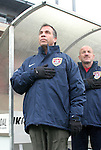 Head coach Bruce Arena (left) and assistant coach Glenn Myernick (right), of the United States, during the pregame anthem on Sunday, February 19th, 2005 at Pizza Hut Park in Frisco, Texas. The United States Men's National Team defeated Guatemala 4-0 in a men's international friendly.