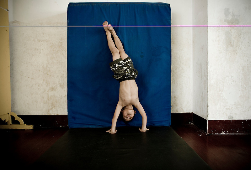 Chinese children train in a gymnastics school in Xiantao, in Hubei province