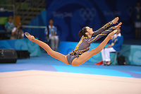 August 23, 2008; Beijing, China; Rhythmic gymnast Anna Bessonova of Ukraine split leaps to re-catch clubs on way to winning bronze in the Individual All-Around final at 2008 Beijing Olympics..(©) Copyright 2008 Tom Theobald