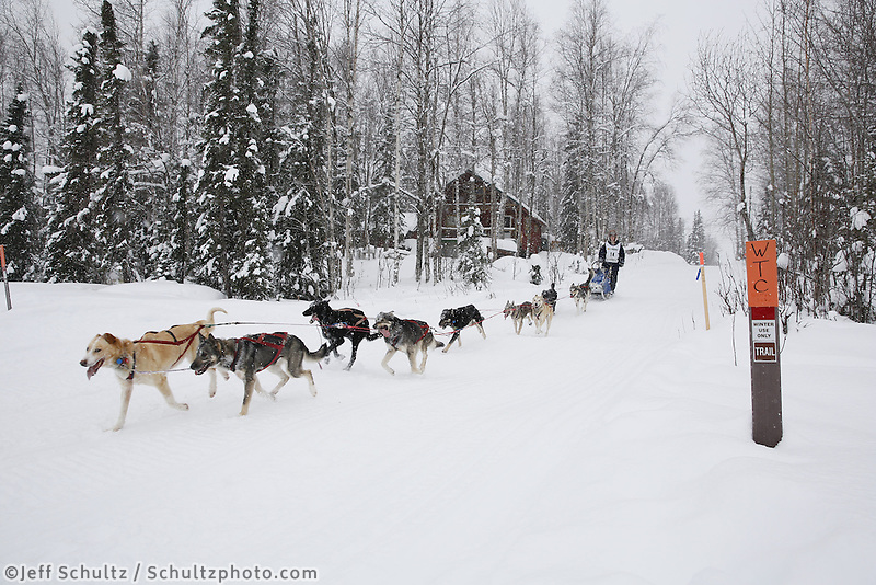 Ben Harper runs on the trail nearing the finish of the 2013 Junior Iditarod.  Willow Alaska..Photo by Jeff Schultz/IditarodPhotos.com   Reproduction prohibited without written permission