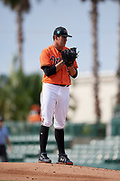 Baltimore Orioles pitcher Grayson Rodriguez (58) looks in for the sign during a Florida Instructional League game against the Pittsburgh Pirates on September 22, 2018 at Ed Smith Stadium in Sarasota, Florida.  (Mike Janes/Four Seam Images)