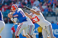 January 02, 2012:    Florida Gators quarterback John Brantley (12) fires a pass under the pressure of Ohio State Buckeyes defensive lineman Garrett Goebel (53) during first half action at the 2012 Taxslayer.com Gator Bowl between the Florida Gators and the Ohio State Buckeyes at EverBank Field in Jacksonville, Florida.