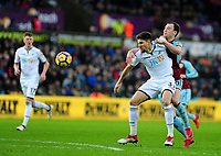 Swansea City's Federico Fernandez vies for possession with Burnley's Ashley Barnes<br /> <br /> Photographer Ashley Crowden/CameraSport<br /> <br /> The Premier League - Swansea City v Burnley - Saturday 10th February 2018 - Liberty Stadium - Swansea<br /> <br /> World Copyright &copy; 2018 CameraSport. All rights reserved. 43 Linden Ave. Countesthorpe. Leicester. England. LE8 5PG - Tel: +44 (0) 116 277 4147 - admin@camerasport.com - www.camerasport.com