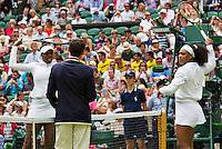 England, London, Juli 06, 2015, Tennis, Wimbledon, De sisters Venus (L) and Serena Williams (USA) during the toss on centrecourt<br /> Photo: Tennisimages/Henk Koster