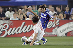 23 April 2009:  Alfredo Pacheco (16) of the Red Bulls slide tackles the ball away from Claudio Lopez (right) of the Wizards.  The MLS Kansas City Wizards defeated the visiting New York Red Bulls 1-0 at Community America Ballpark in Kansas City, Kansas.