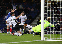 Dean Shiels shoots wide as Derek Young and goalkeeper Lee Robinson cover in the Rangers v Queen of the South Quarter Final match in the Ramsdens Cup played at Ibrox Stadium, Glasgow on 18.9.12.