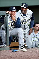 Manager Pedro Lopez (32), left, and pitching coach Jonathan Hurst (48) of the Columbia Fireflies in a game against the Greenville Drive on Wednesday, April 18, 2018, at Fluor Field at the West End in Greenville, South Carolina. Columbia won 8-4. (Tom Priddy/Four Seam Images)