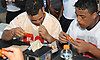 Freddy Pantaleon of Cardinal Hayes High School, left, and Mahmoud Shabana of Brooklyn Tech participate in a chicken wing eating contest featuring the senior football all-stars from New York City against their Long Island counterparts at Hofstra University on Saturday, June 18, 2016. The teams will face each other on the gridiron in the 21st annual Empire Challenge at Hofstra on Tuesday, June 21.
