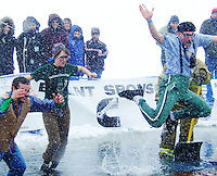 Ben Ruyle (right) jumps into frozen Lake Monona, followed by Nate Ruyle and Kelly Hofer at Polar Plunge at Olin Park on Saturday in Madison
