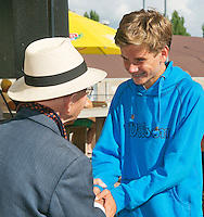 August 9, 2014, Netherlands, Rotterdam, TV Victoria, Tennis, National Junior Championships, NJK, Winner boys 14 years Alec Deckers is being congratulated by opa Scheer<br /> Photo: Tennisimages/Henk Koster