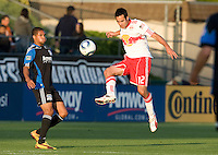 Mike Petke of Red Bull controls the ball away from Ryan Johnson of Earthquakes during the first half of the game at Buck Shaw Stadium in Santa Clara, California.  San Jose Earthquakes defeated New York Red Bulls, 4-0.