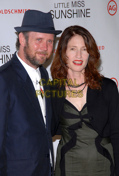 """JONATHAN DAYTON & VALERIE FARIS .Premiere of """"Little Miss Sunshine"""" at AMC Loews Lincoln Square, New York, NY, USA..July 25th, 2006.Photo: Paul Hawthorne/AdMedia/Capital Pictures  .Ref: ADM/PH.half length blue suit hat green dress black jacket.www.capitalpictures.com.sales@capitalpictures.com.©AdMedia/Capital Pictures. *** Local Caption ***"""