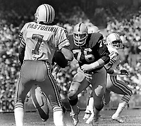 Raider lineman Mike Mcoy after Houston Oiler QB Dan Pastorini.  (1977 photo/Ron Riesterer)