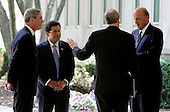 Langley, VA - May 31, 2006 -- Four of the top United States Justice Department and Intelligence officials, left to right: Federal Bureau of Investigation (FBI) Director Robert Mueller;  Attorney General Alberto Gonzales; National Security Advisor Stephen Hadley; and National Intelligence Director John Negroponte talk outside Central Intelligence Agency (CIA) headquarters following a ceremonial swearing in for new CIA Director General Michael Hayden in Langley, Virginia Wednesday 31 May 2006. <br /> Credit: Matthew Cavanaugh-Pool via CNP