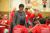 First lady Michelle Obama participates in a community service event at the Stuart Hobson Middle School Service Project in Washington, D.C. on Monday, January 17, 2011 to honor the birthday of Dr. Martin Luther King Jr. .Credit: Dennis Brack / Pool via CNP
