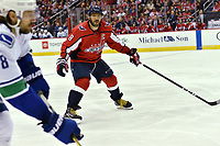 WASHINGTON, DC - FEBRUARY 05: Washington Capitals left wing Alex Ovechkin (8) plays defense during the Vancouver Canucks vs. the Washington Capitals NHL game at Capital One Arena in Washington, D.C.. (Photo by Randy Litzinger/Icon Sportswire)