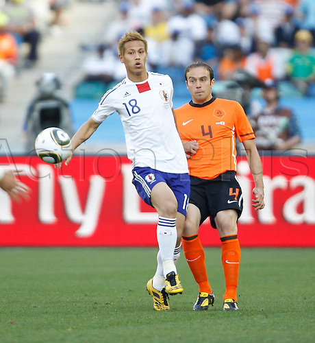 19-06-2010  Netherlands Joris Mathijsen vies with Japan Keisuke Honda during their 2010 World Cup Group E Soccer Match at Moses Mabhida stadium in Durban South Africa on June 19 2010