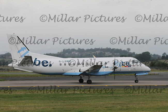 A Saab 340B Registration G-LGNH of Flybe taxiing at Glasgow Airport on 29.9.14.