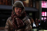 A man pauses along the street  as Low temperatures hit New York, United States. 23/01/2013 Photo by Kena Betancur/VIEWpress.