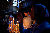 Devotees attend church at Moscow's Srentenski Monastery, home to the world-famous Srentenski Monastery Choir, led by conductor Nikon Zhila.