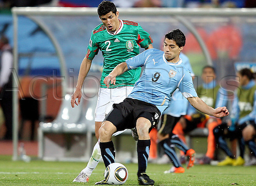 22 06 20102010 FIFA World Cup, Mexico v Uruguay, played at the Royal Bafokeng stadium, Rustenburg, South Africa. Picture shows Franciso Rodriguez MEX and Luis Soarez Uru