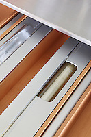 One of the bespoke drawers in the kitchen island has been designed for cling film and foil
