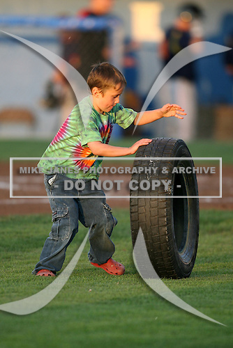 September 1, 2009:  Fans of the Batavia Muckdogs take part in an on field promotion during a game at Dwyer Stadium in Batavia, NY.  The Muckdogs are the Short-Season Class-A affiliate of the St. Louis Cardinals.  Photo By Mike Janes/Four Seam Images