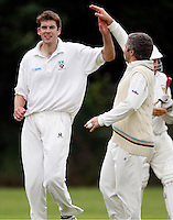 Joel Gregory (L) of Hornsey is high fived after dismissing a Shepherds Bush player during the Middlesex County League Division two game between Shepherds Bush and Hornsey at Bromyard Avenue, East Acton on Sat July 23, 2011