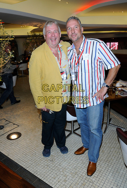 CHRISTOPHER BIGGINS & IAN BOTHAM  .Virgin Atlantic's 25th Birthday Party, Heathrow Airport, London, England..June 22nd, 2009.full length black trousers jeans denim red white blue striped stripes shirt brown yellow jacket .CAP/FIN.©Steve Finn/Capital Pictures.