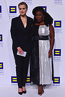 Washington, DC - October 28, 2017: Actresses Taylor Schilling and Uzo Aduba pose on the carpet at the Human Rights Campaign's National Dinner held at the Washington Convention Center October 28, 2017. Both women are known for their roles on the primetime series 'Orange is the New Black.' (Photo by Don Baxter/Media Images International)