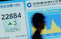 A passerby passes by a large-size electronic broad which shows the Hang Seng Index(HSI) and other relevant informations of the banks, Hong Kong SAR, China. The Hang Seng Index is a freefloat-adjusted market capitalization-weighted stock market index in Hong Kong. It is used to record and monitor daily changes of the largest companies of the Hong Kong stock market and is the main indicator of the overall market performance in Hong Kong..