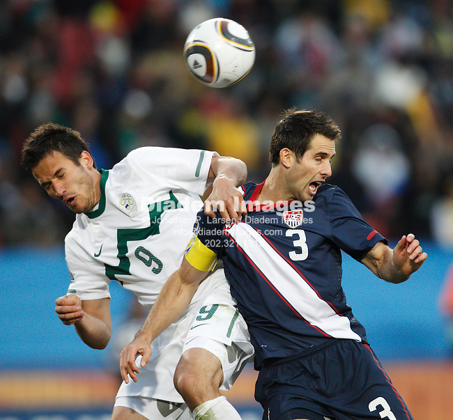 JOHANNESBURG - JUNE 18:  Zlatan Ljubijankic of Slovenia (l) and Carlos Bocanegra of the United States (r) battle for the ball during a 2010 FIFA World Cup fsoccer match June 18, 2010 in Johannesburg, South Africa.  NO mobile use.  Editorial ONLY.  (Photograph by Jonathan P. Larsen)