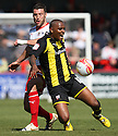 Jon Ashton of Stevenage and Clinton Morrison of Brentford challenge. - Stevenage v Brentford - npower League 1 - Lamex Stadium, Stevenage - 21st April, 2012. © Kevin Coleman 2012
