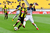 Melbourne Victory&rsquo;s Kosta Barborouses and Wellington Phoenix&rsquo; Scott Galloway in action during the A League - Wellington Phoenix v Melbourne Victory FC at Westpac Stadium, Wellington, New Zealand on Sunday 3 December.<br /> Photo by Masanori Udagawa. <br /> www.photowellington.photoshelter.com