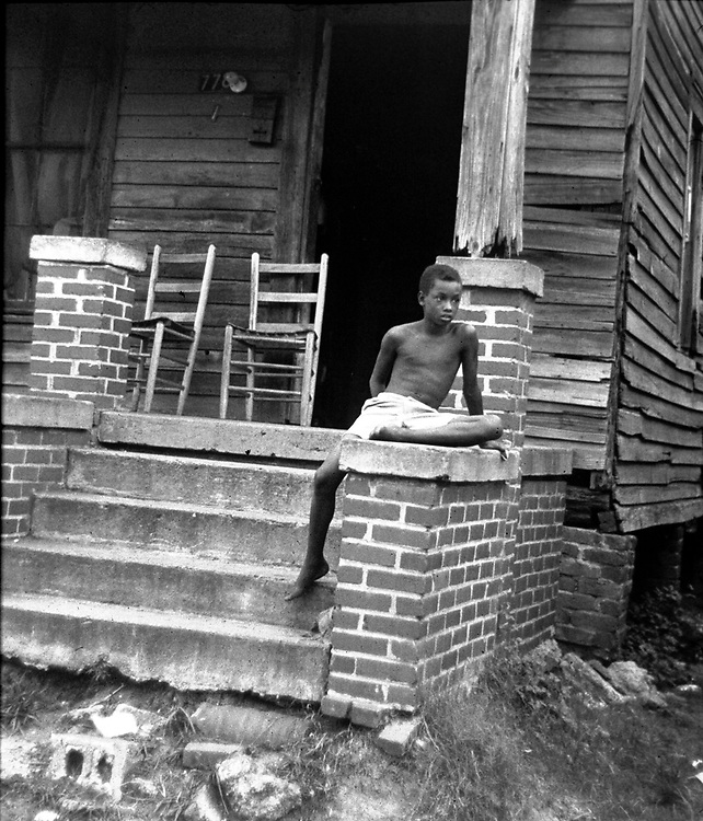 Young boy of Newtown area of Montgomery, Ala, sits on porch. From an essay photographed by Jim Peppler for The Southern Courier in August, 1967. Copyright Jim Peppler/1967. This and over 10,000 other images are part of the Jim Peppler Collection at The Alabama Department of Archives and History:  http://digital.archives.alabama.gov/cdm4/peppler.php