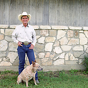 Cowboy Church. Texas, USA. 2007. Pastor Ron and his cattle dog will. Ron is the head preacher at the 1,000 Hills Cowboy Church.