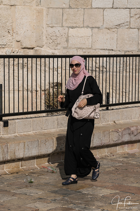 A Palestinian Arab women wearing the traditional Muslim hajib or head scarf by the Damascus Gate in East Jerusalem.
