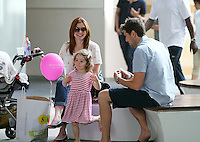 "Is that a Robot-Dance? Alyson Hannigan and hubby Alexis Denisof crack up while little Satyana horses around during a shopping break at the Santa Monica mall. Baby Keeva_was sleeping in the stroller while Alyson and Alexis talked about the newly purchased cute baby romper with the ""i'm going back to CALI"" print. Notice Alyson's trendy cupcake-print blouse! Los Angeles, California on 3.8.2012..Credit: Correa/face to face.. / Mediapunchinc  ***online only for the weekly magazines***** /NortePhoto.com<br />