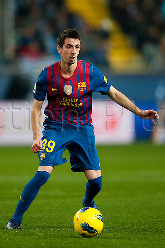 22.01.2012 Malaga, Spain. The La Liga football match between FC Malaga and FC Barcelona played in the La Rosaleda Stadium. Image shows, Isaac Cuenca (FC Barcelona)..
