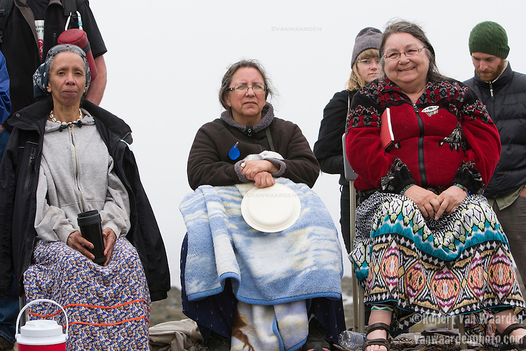 (l-r) Willi Nolan, long time activist, Hart Perley, Clan Mother, and Alma Brooks, Wolastoq Clan Mother. Three powerful elders at the #EndoftheLine. On May 30, 2015, over 500 Canadian citizens and First Nations marched in Red Head, Saint John, at the End of the Line for the proposed Energy East pipeline. The people were protesting the proposed mega pipeline and the tank terminal that would destroy and the Red Head community and endanger the Bay of Fundy. If approved, TransCanada's Energy East pipeline would travel 4600km from Alberta to Saint John, New Brunswick, shipping 1.1 million barrels of crude oil and bitumen for export through the Bay of Fundy, a critical habit for Right whales and home to thousands of jobs in Tourism and Fishing.