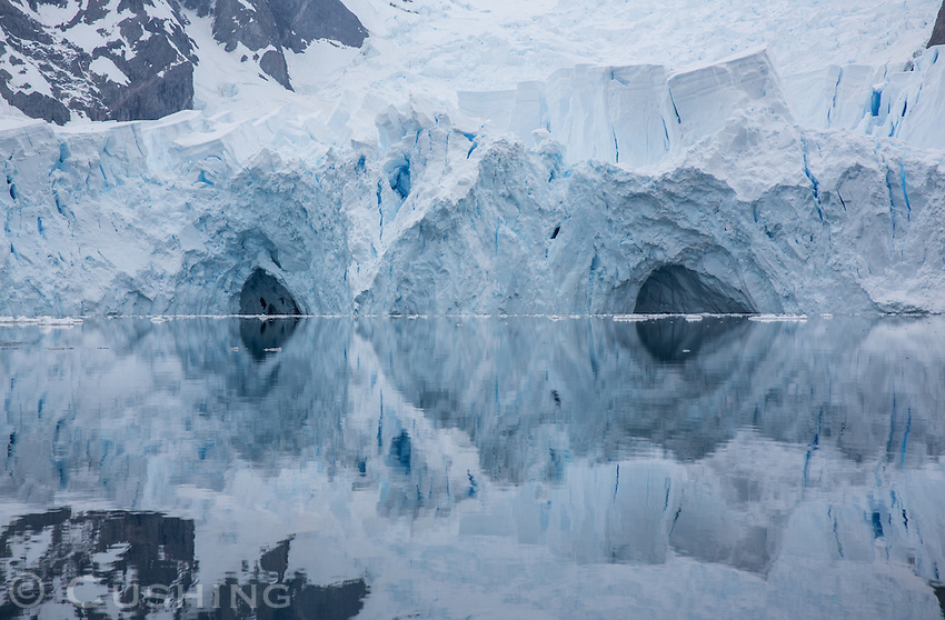 Glacier Reflection in the early morning stillness of Paradise Bay, Antarctica